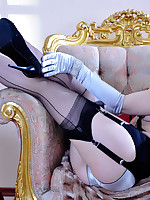 Stunning show-girl rolls down her black FF stockings with her gloved hands